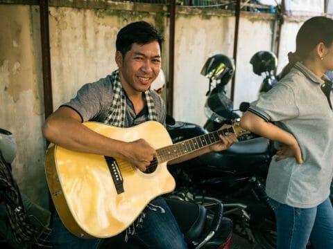 Konthea plays guitar as part of Children in Families church partnership program