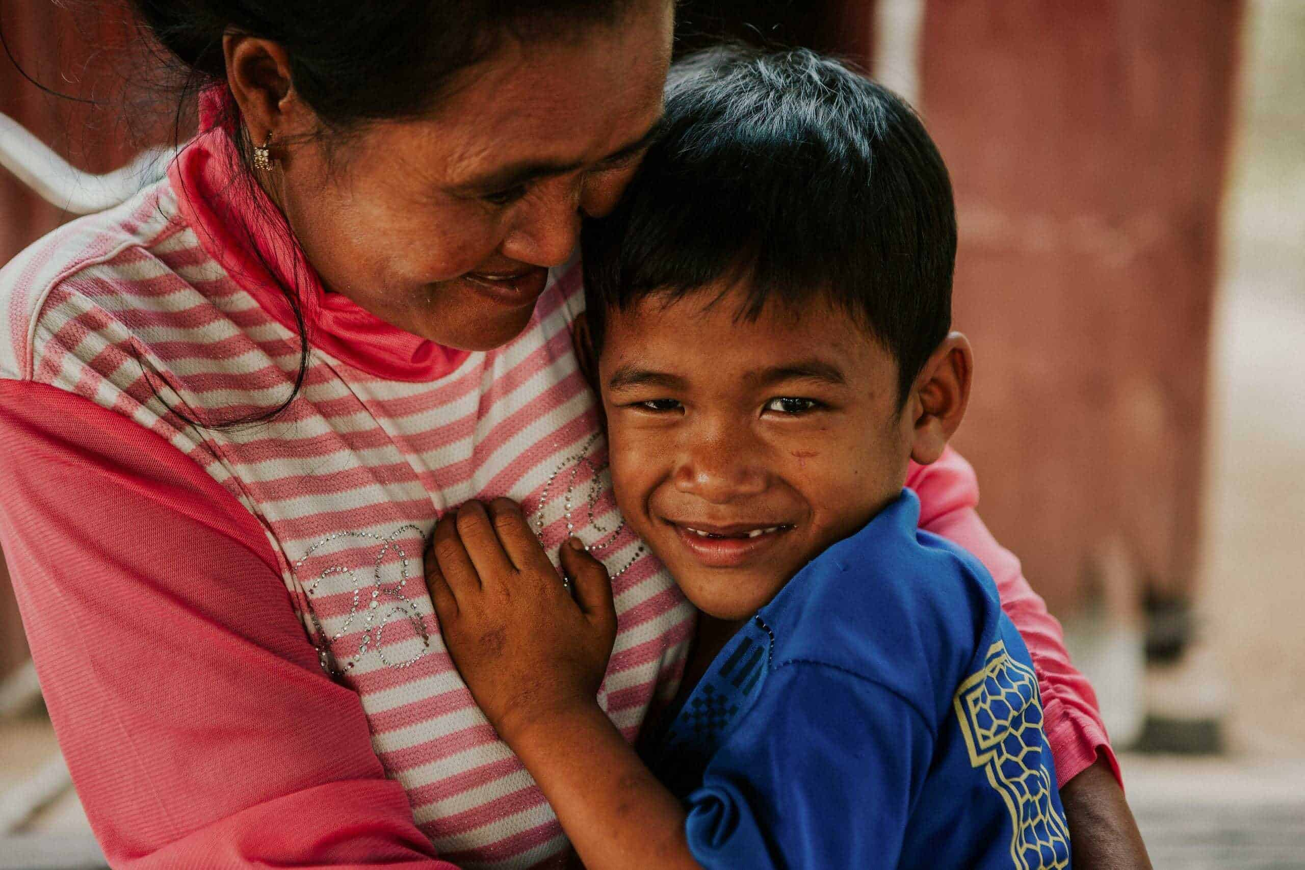 Hugs for mum: A young boy is all smiles as he hugs his Children in Families foster mum